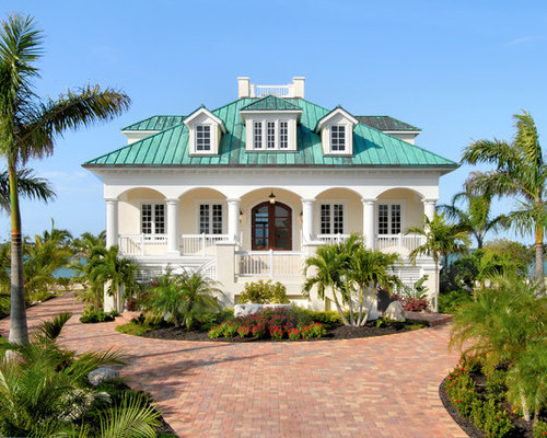 Delightful Example Of A Large Island Style Beige Two Story Stucco Exterior Home Design  In Miami Design