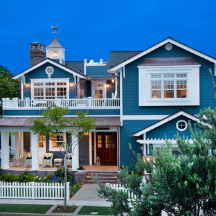 Beach style blue two-story mixed siding gable roof idea in San Diego