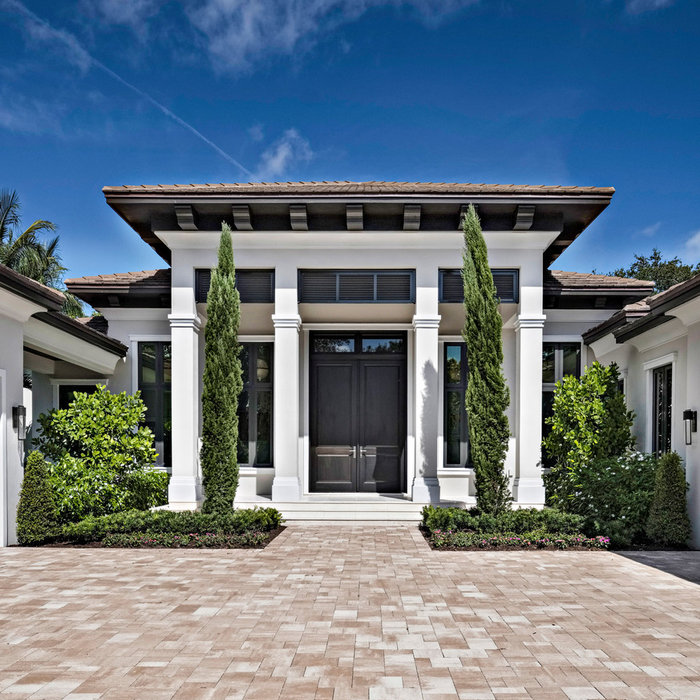 Mid-sized transitional one-story house exterior photo in Miami with a hip roof and a tile roof