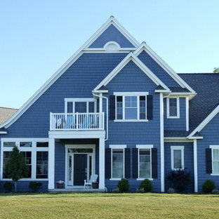 Inspiration for a large transitional blue two-story wood exterior home remodel in New York with a shingle roof