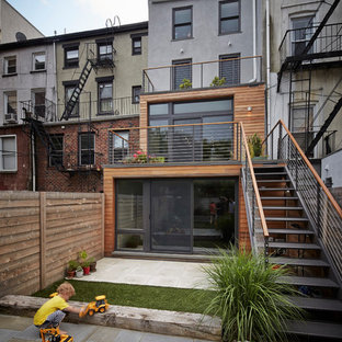Mid-sized trendy gray three-story wood exterior home photo in New York