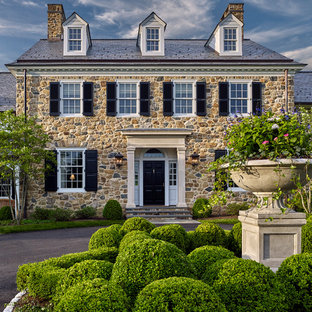 Traditional beige two-story stone exterior home idea in Philadelphia with a shingle roof