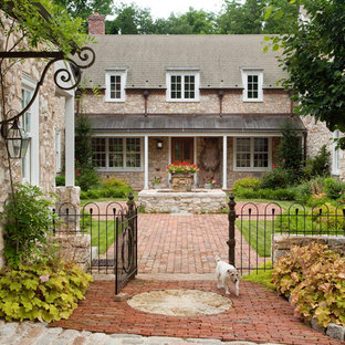 Photo of a gey rural two floor detached house in Philadelphia with stone cladding, a pitched roof and a shingle roof.