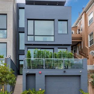 Источник вдохновения для домашнего уюта: большой, четырехэтажный, серый частный загородный дом в стиле модернизм с облицовкой из цементной штукатурки и плоской крышей