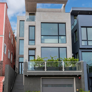 Large contemporary stucco grey exterior in San Francisco with a flat roof.