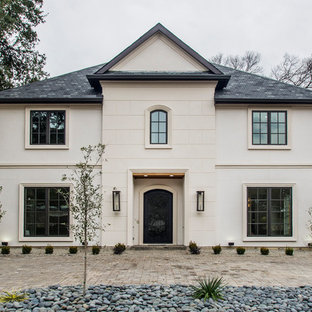 Transitional beige two-story house exterior idea in Dallas with a hip roof and a shingle roof