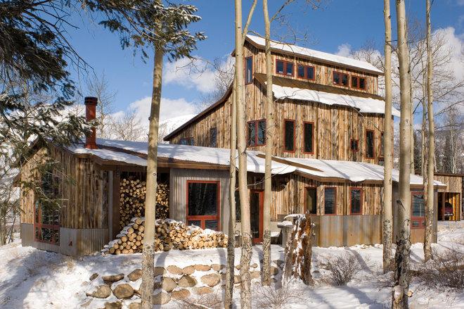 Rustic Exterior by Allen-Guerra Architecture