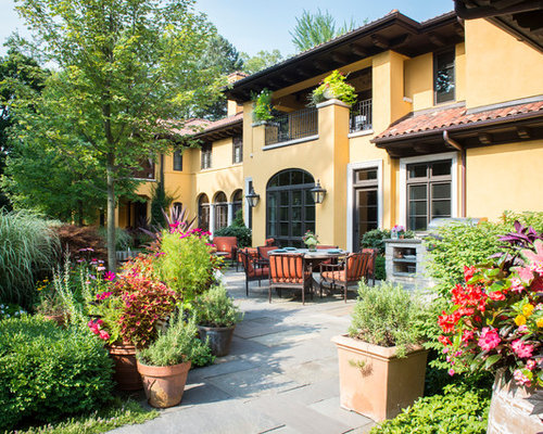 exterior home designs. Example of a tuscan yellow two story stucco exterior home design in Chicago  with Exterior Home Ideas Design Photos Houzz