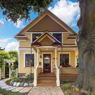 Inspiration for a victorian yellow concrete fiberboard exterior home remodel in Seattle with a shingle roof