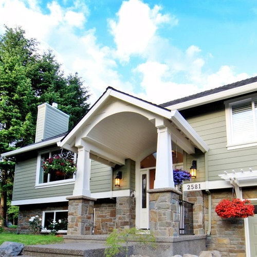 Large Traditional Green Split Level Gable Roof Idea In Portland