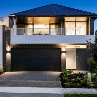 Contemporary two-storey brick black house exterior in Perth with a hip roof and a metal roof.