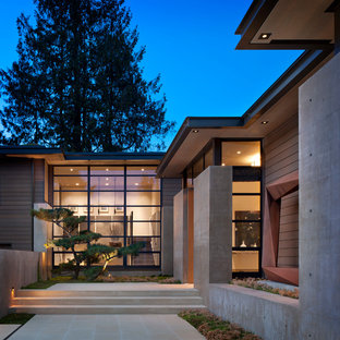 Inspiration for a contemporary one-story wood exterior home remodel in Seattle