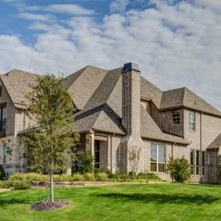 Example of a huge tuscan brown two-story brick exterior home design in Dallas