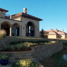 Mediterranean Exterior by Clayburn Development & Pools by Dreamscapes
