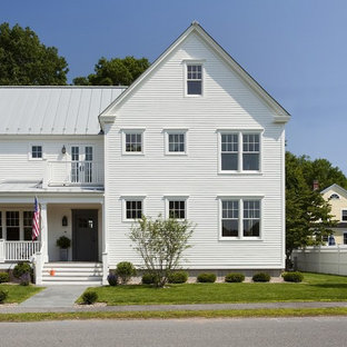 Mid-sized traditional three-story wood gable roof idea in Boston