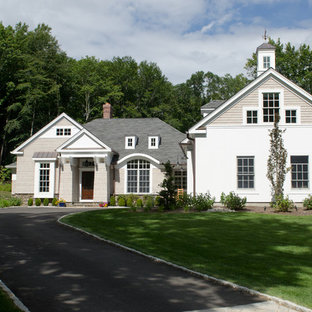Example of a large farmhouse beige two-story mixed siding exterior home design in New York with a shingle roof