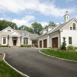 Inspiration for a large country beige two-story mixed siding exterior home remodel in New York with a shingle roof
