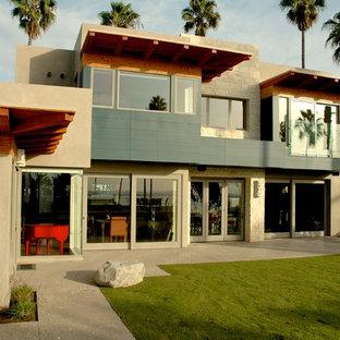 Modelo de fachada contemporánea con revestimiento de piedra