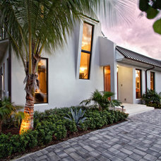 Tropical Exterior by Village Architects AIA, Inc.