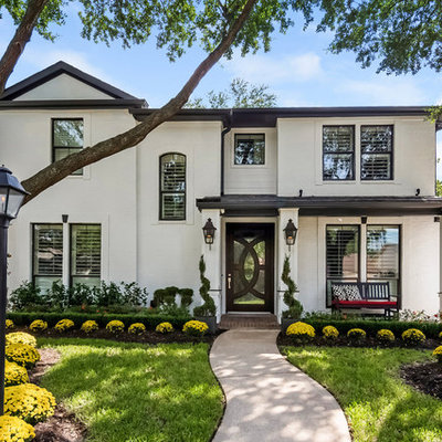 Mid-sized transitional white two-story house exterior idea in Houston with a hip roof and a shingle roof