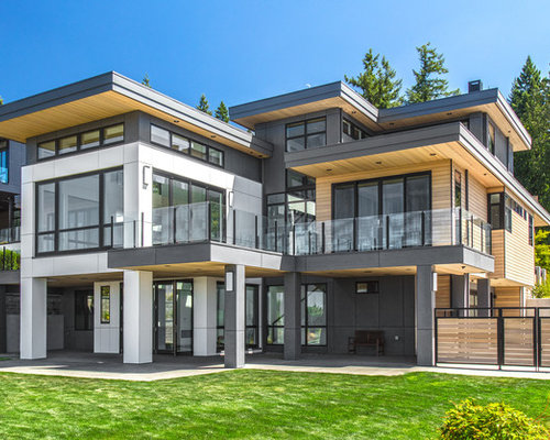 Large Trendy Multicolored Two Story Mixed Siding Flat Roof Photo In Seattle  With A Metal
