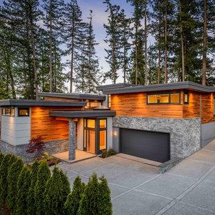 Idee per la facciata di una casa contemporanea a due piani con rivestimenti misti e tetto a una falda
