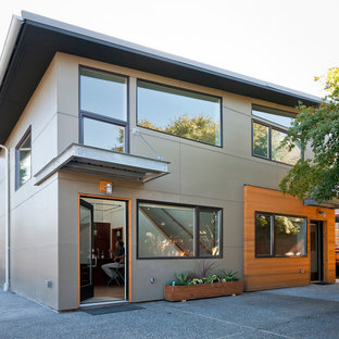 Inspiration for a mid-sized contemporary concrete fiberboard exterior home remodel in Seattle with a shed roof