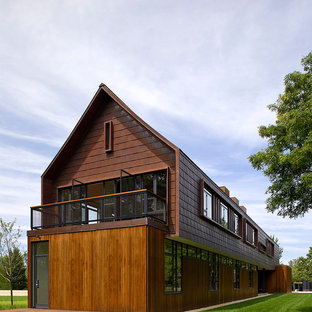 Inspiration for a contemporary brown two-story wood exterior home remodel in New York