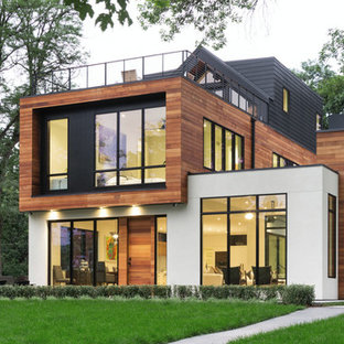 Contemporary multicolored three-story mixed siding flat roof idea in Minneapolis