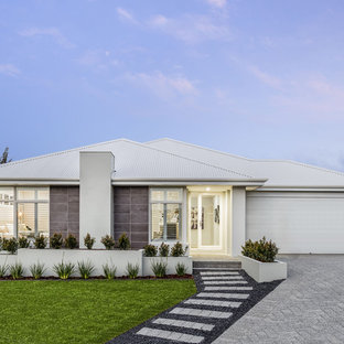 Design ideas for a mid-sized contemporary one-storey grey house exterior in Perth with a metal roof, stone veneer and a gable roof.