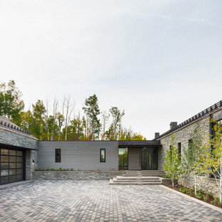 Contemporary gray one-story mixed siding exterior home idea in Denver