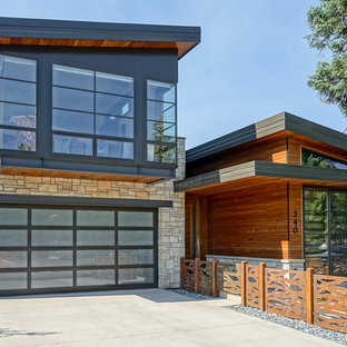 Design ideas for a contemporary house exterior in Other with mixed siding and a shed roof.