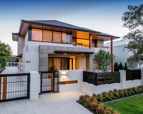 Example of a large trendy white two-story stucco exterior home design in  Perth with