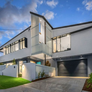 Design ideas for a contemporary two-storey white exterior in Brisbane.