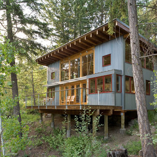 Example of a mountain style metal exterior home design in Seattle with a shed roof