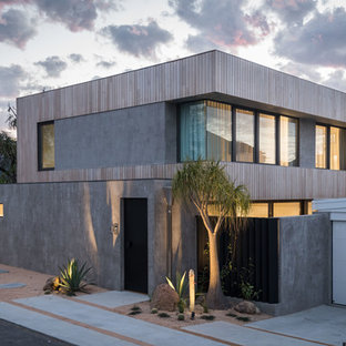 Small contemporary two-storey grey house exterior in Perth with mixed siding and a flat roof.