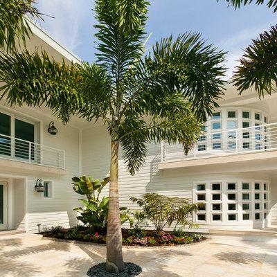 Huge contemporary white two-story concrete fiberboard exterior home idea in Tampa