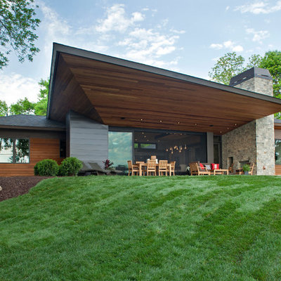 Example of a trendy mixed siding exterior home design in Minneapolis