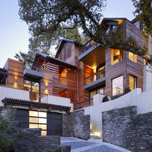 This is an example of a contemporary exterior in San Francisco with wood siding.