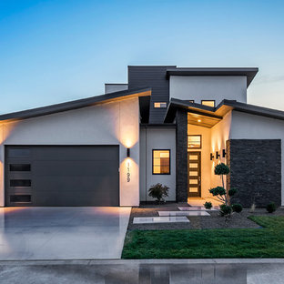Large contemporary gray two-story mixed siding house exterior idea in Boise with a shed roof and a green roof