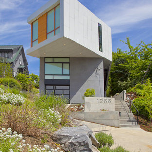 Mid-sized trendy gray two-story mixed siding flat roof photo in Seattle