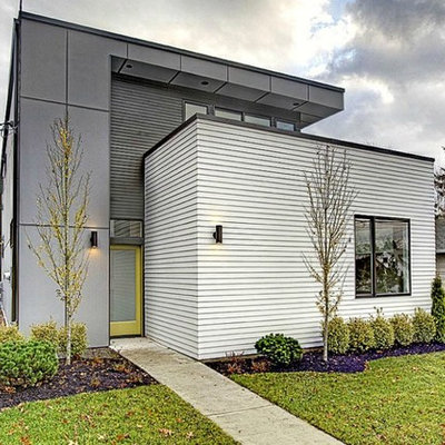 Mid-sized contemporary gray two-story mixed siding flat roof idea in Seattle