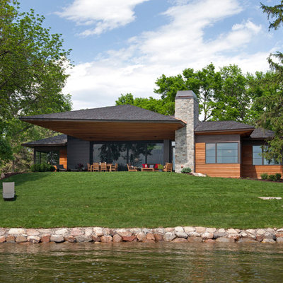 Example of a trendy wood exterior home design in Minneapolis with a hip roof