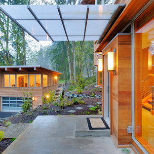 Example of a trendy wood exterior home design in Seattle