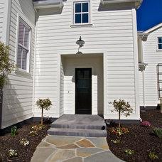 Farmhouse Exterior by KCS, Inc.