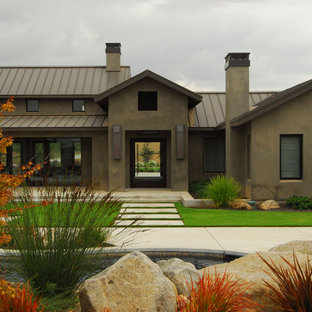 Inspiration For A Country Stucco Exterior Home Remodel In Sacramento With Metal Roof