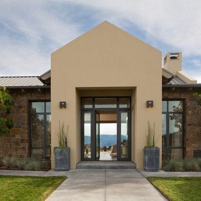 Example of a trendy stone exterior home design in Santa Barbara