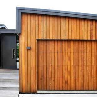 Свежая идея для дизайна: маленький, одноэтажный, деревянный, коричневый дом в современном стиле с односкатной крышей - отличное фото интерьера