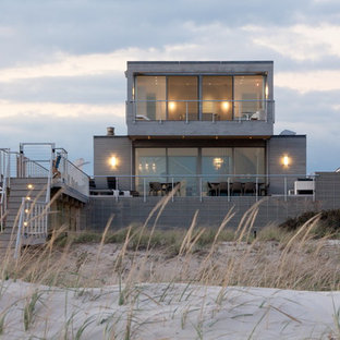Inspiration for a beach style two-story flat roof remodel in New York