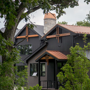 Large trendy black three-story mixed siding exterior home photo in Milwaukee with a mixed material roof